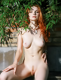 WIld and sexy redhead babe Natalia A takes off her clothes and shows her trimmed wet fanny.