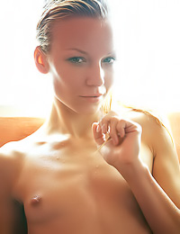 Passionate blonde lady Gwyneth A takes her clothes off and takes a shower for the camera.