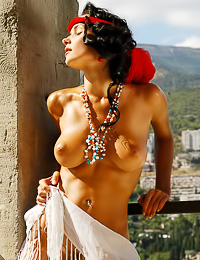 Big breasted brunette hottie Jenya D strips on the balcony and shows us her massive jugs.