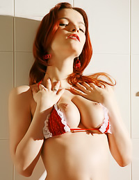 Ulya I: Classy big breasted redhead model Ulya I takes off her sexy red lingerie and shows her big jugs.