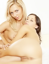 Attractive lesbian gals Lena D and Yulia A take off their clothes on the bed and show off.