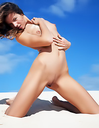 Horny blonde babe Altea B poses fully nude on the beach and shows her wet juicy pink hole.