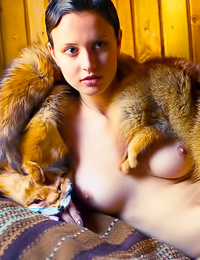 Passionate brunette vixen Hilary A takes off her fur coat and shows us her beautiful breasts.