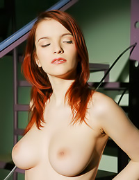 Round breasted redhead angel Ulya I takes off her black lace shirt and shows her huge rack.