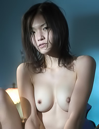 Asuka A: Smoking hot Asian model Asuka A takes off her black clothes and shows her hairy muff.