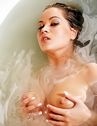 Round breasted blonde gal Mira A takes off her clothes and takes a hot bath before the cam.