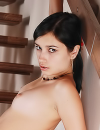Foxy brunette teen chick Tanita A takers her little thongs on the stairs and shows her body.