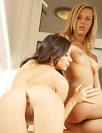 Attractive lesbo babes Lena D and Yulia A strip together and play with their bouncy breasts.