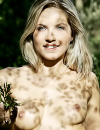 Amazingly sexy and seductive blonde Jenni A strips in the woods and shows her round cupcakes.