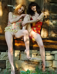 Lusty lesbo girls Olga K and Rita E take off their clothes outdoors and make out passionately.