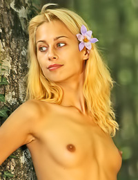 Vika J: Small breasted blonde chick Vika J takes off her clothes in the woods and shows us her tits.