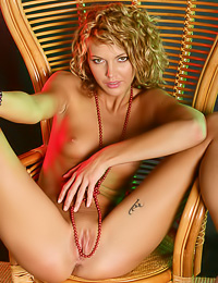 Lusty blonde hottie Lilly A spreads her long sexy legs and shows her gaping wet muff.