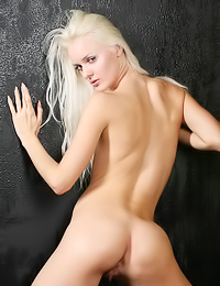 Vika T: Attractive blonde lady Vika T takes off her black top and teases in slutty black boots.