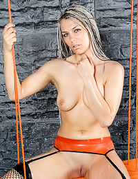 Classy blonde chick Eva C teases in kinky lingerie and shows her trimmed dripping twat.