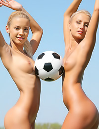 Cute teen gals Marina C and Sandy A take off their sexy clothes and play soccer outdoors.