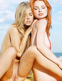 Passionate dyke ladies Inga C and Natalia A passionately kiss and make out on the beach.