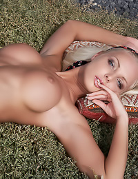 Busty blonde bimbo Victoria B poses nude outdoors and shows us her huge massive hooters.