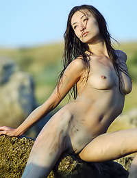 Attractive Asian hottie Niza A poses nude outdoors by the river and shows us her round tits.