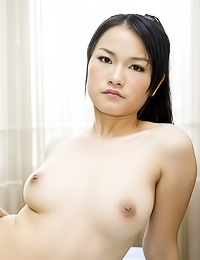 Busty Asian chick Kelly Zhang takes off her panties and shows us her hungry wet hairy beaver.