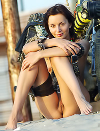 Wild brunette babe Vika I takes off her sexy panties and poses by her nasty motorbike.