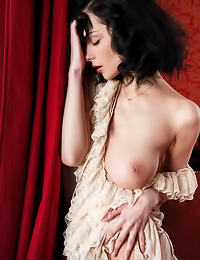 Passionate and attractive brunette gal Jenya D takes off her sexy gown and shows her big jugs.