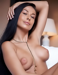 Hene A: Big breasted brunette gal Hene A strips on the bed and reveals her shaved wet pink hole.