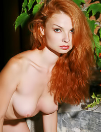 Busty redhead model Natalia A takes off her top and shows us her massive big hooters.