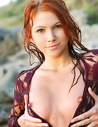 Lovely redhead model Lidiya A takes off her lace top and shows us her fuckable wet muf.