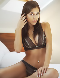 Good looking busty brunette Lucie B take soff her sexy lingerie and shows her massive jugs.