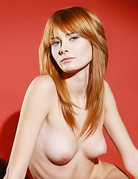 Beautiful and classy redhead chick Iren F slowly strips her sexy dress and shows her breasts.