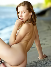 Smoking hot blonde vixen Sasha J takes off her underwear on the beach and exposes her nude body.