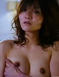 Foxy Asian babe Asuka A takes off her sexy black dress and shows her tight hairy pussy.