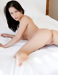 Smoking hot brunette Aprilia A takes her fishnet thongs off and shows her tight firm ass.