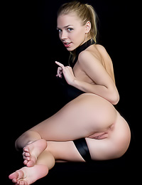 Elegant and classy blonde lady Liv A takes off her black lingerie and shows her hot ass.