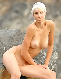 Big, black rock keeps sexy blond girl Zara A warm while posing naked in various positions.