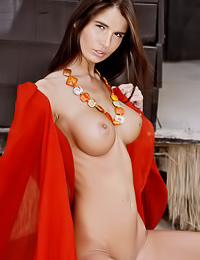 Big breasted brunette vixen Nessa A takes her lace robe off and shows her massive big jugs.