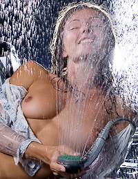 Since she made her shirt wet, she had to take it off and pose naked, while playing with shower.