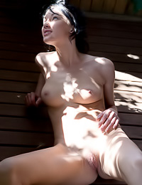 Short hairred brunette hottie Loreen A takes off her sexy dress outdoors and shows her rack.