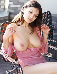 Sofi A lets her pink top slip down and reveal a set of tits that would make any man stare.