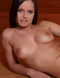 Big breasted brunette vixen Kari A takes her red lingerie off and teases with her tight butt.