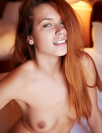 Charming redhead teen cuttie Kami A slowly strips her white thongs and shows her trimmed cunt.