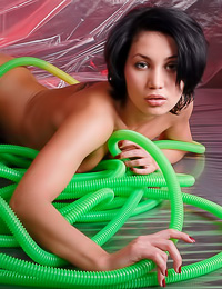 Marissa A: Kinky brunette model Marissa A poses nude and plays with a green hose on her hot body.