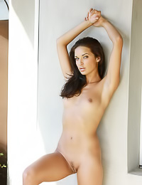 Small breasted brunette hottie Olga M spreads her long sexy legs and shows her trimmed cunt.