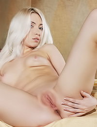 Attractive platinum blonde babe Adele B takes off her slutty black thongs and sexy black bra.