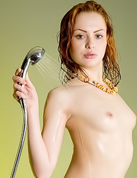Jolie B: Small breasted redhead babe Jolie B takes her lingerie off and takes a wet hot shower.