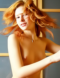Lovely redhead angel Dasha J slowly removes her pink corset and teases in black stockings.