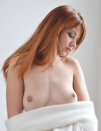 Redhead gal Kami A took her white stockings and thongs off and showed us her hungry wet twat.
