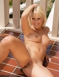 Veronika J loves to pose on her balcony without any clothes on and to play with her pet.