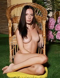 Nika E: Horny brunette gal Nika E takes off her clothes and shows her smoking hot tanned body.