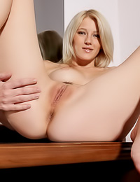 Foxy blonde gal Mila I takes her slutty dress off and stretches her shaved hungry pink hole.